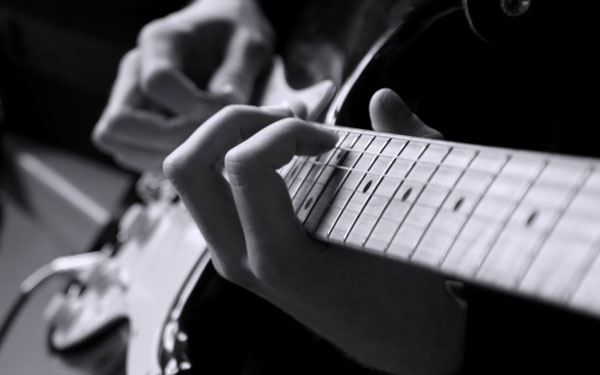 Playing the electric guitar